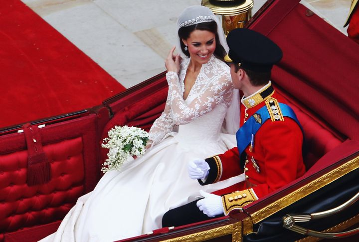 Prince William and the Duchess of Cambridge prepare to begin their journey by carriage procession to Buckingham Palace following their marriage at Westminster Abbey.