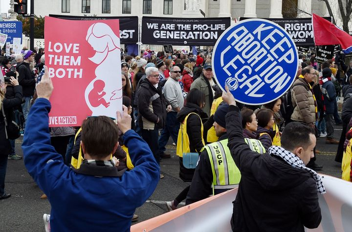Pro-choice and anti-abortion activists demonstrate in front of the U.S. Supreme Court on Jan. 24, 2020.