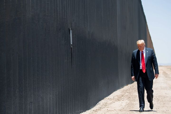 Then-President Donald Trump participates in a ceremony commemorating the completion of the 200th mile of border wall in June