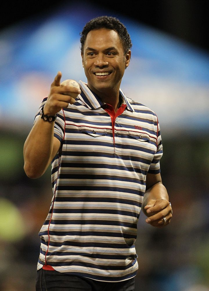 SAN JUAN, PUERTO RICO - JUNE 30:  Roberto Alomar Jr. throws out the first pitch before the game between the New York Mets and