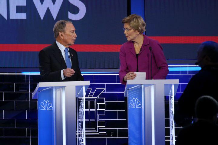 Former New York City Mayor Mike Bloomberg and Sen. Elizabeth Warren (D-Mass.) speak during the Democratic presidential primar