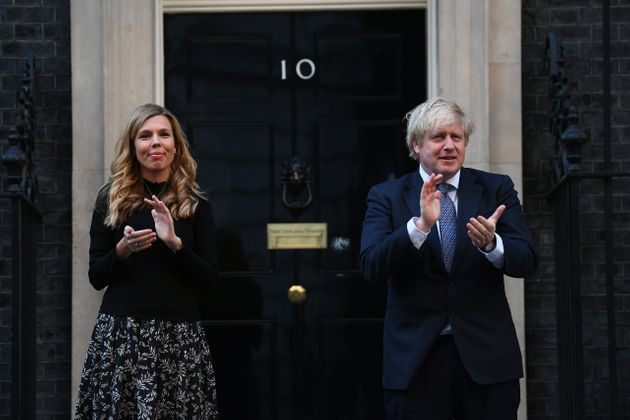 Prime Minister Boris Johnson and his partner Carrie Symonds, stand in Downing Street, London, to join...