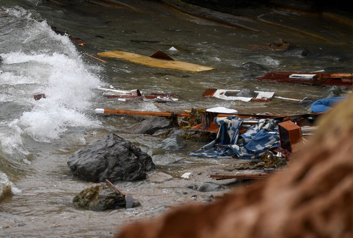Wreckage and debris from a capsized boat washes ashore at Cabrillo National Monument near where a boat capsized just off the