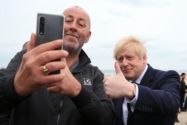 Boris Johnson poses for a 'selfie' photograph as he meets members of the public while campaigning in