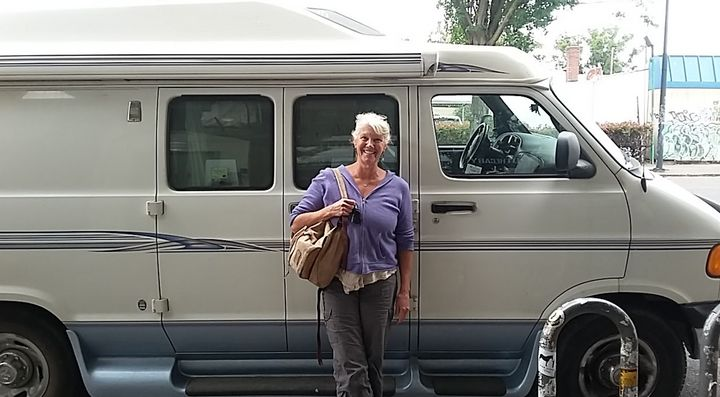 "The author standing in front of her van, ""Roadcinante,"" in downtown Portland, Oregon (2017)."