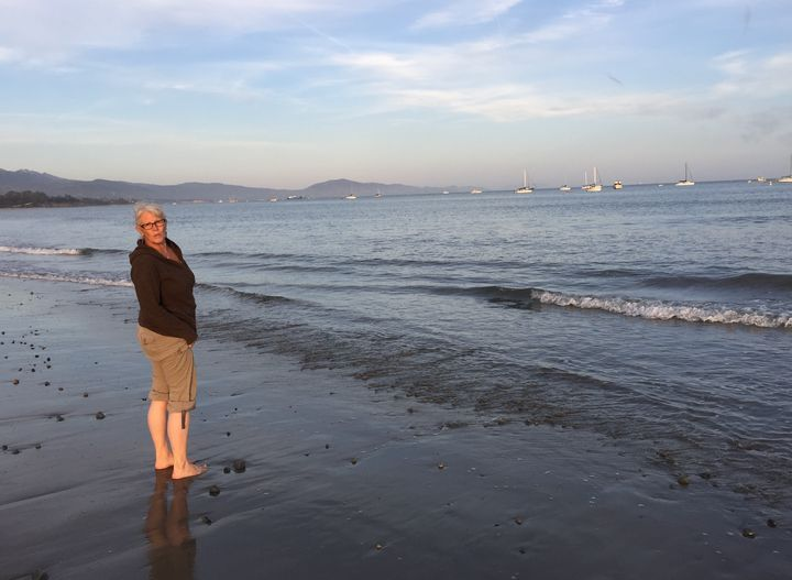 The author with her feet in the Pacific Ocean in Santa Barbara, California (2017).