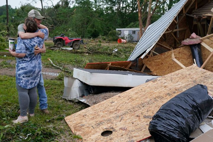 A neighbor hugs Vickie Savell next to the remains of her new mobile home early Monday, May 3, 2021, in Yazoo County, Miss.