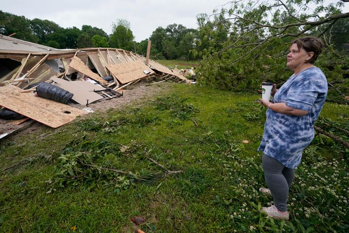 Vickie Savell looks at the remains of her new mobile home early Monday, May 3, 2021, in Yazoo County, Miss.