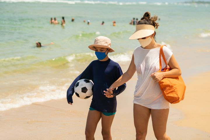 Experts say wearing a mask at the beach likely isn't necessary.