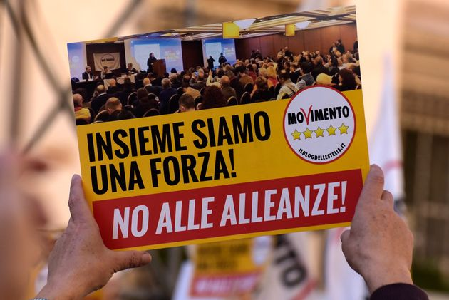 ROME, ITALY - 2020/02/15: A sign on the unity of the Movimento Cinque Stelle is shown during the demonstration...
