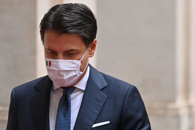 Italy's outgoing Prime Minister, Giuseppe Conte leaves on February 13, 2021 following a formal handover...