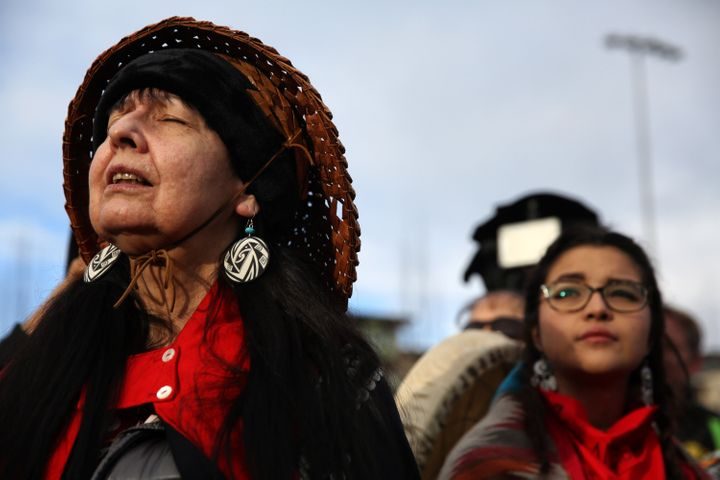 Ellany Kayce of Tlingit Nation closes her eyes and listens to a song performed by members of the Native community before thou