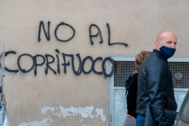 During the night, writings appeared against the 10 p.m. curfew of the Draghi government in Rieti, Italy,...