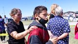 Alela Rodriguez, left, walks with her son, Yandel Rodriguez, 12, at the high school where people were evacuated after a shooting at the nearby Rigby Middle School earlier Thursday, May 6, 2021, in Rigby, Idaho. Authorities said that two students and a custodian were injured, and a male student has been taken into custody. (AP Photo/Natalie Behring)