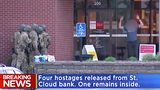 A standoff at a St. Cloud, Minnesota bank ended peacefully with the release of hostages and the suspect's arrest.