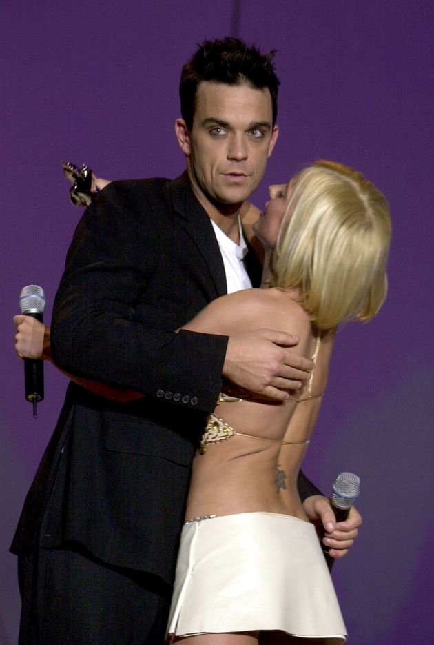 Robbie Williams and Geri Halliwell share a hug at the