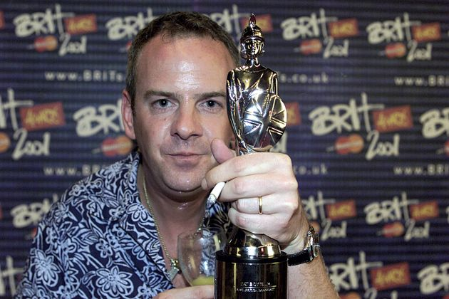 Norman Cook of Fatboy Slim poses with his Brit