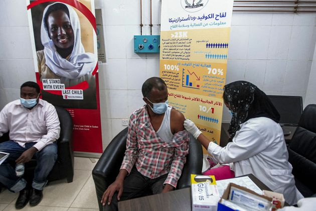 A man receives a dose of the Oxford-AstraZeneca COVID-19 coronavirus vaccine at the Jabra Hospital for...