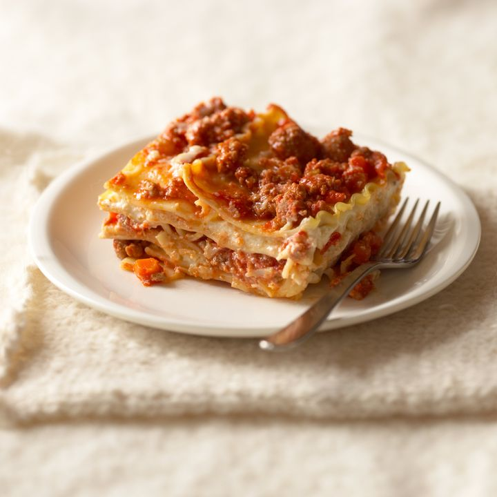 Reheating lasagna can liberate some of the flavor molecules that have been trapped inside the starch of the pasta.