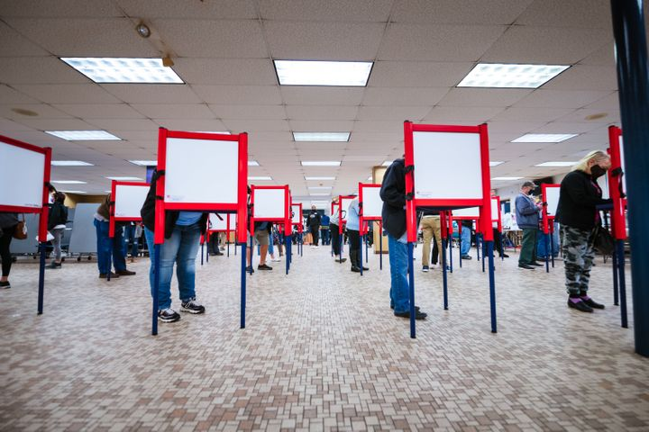 Voters stand at ballot boxes and cast their votes at Fairdale High School on Nov. 3, 2020, in Louisville.
