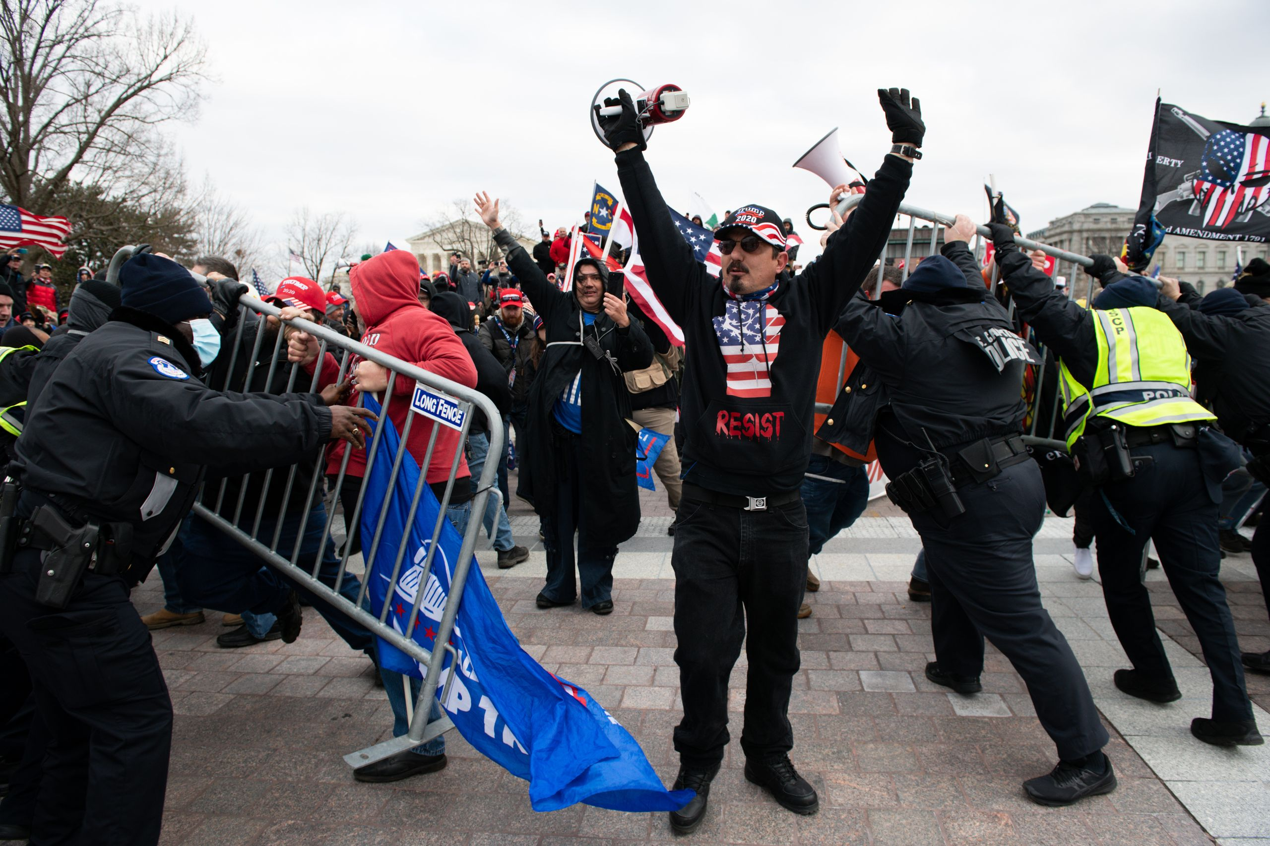 Demonstrators breach security fencing during a protest outside the U.S. Capitol in Washington, D.C., U.S., on Wednesday, Jan.