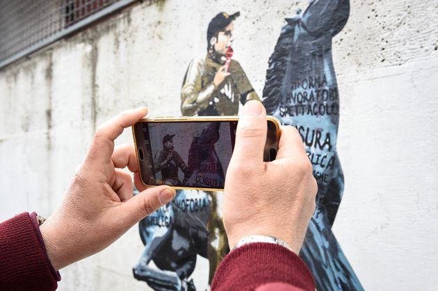 Non è la Rai. The new mural by street artist H. Greb, created near the Rai headquarters. The work depicts...