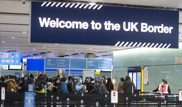 LONDON, ENGLAND - FEBRUARY 11: People queue at UK border control at Terminal 2 at Heathrow Airport on...