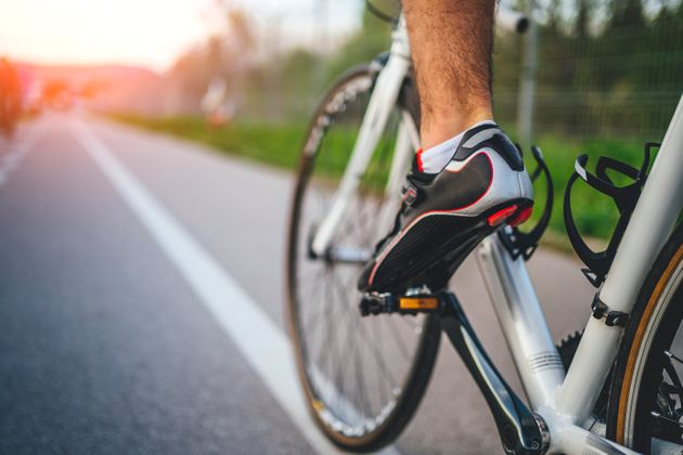 Cycling sport, feet on pedal of