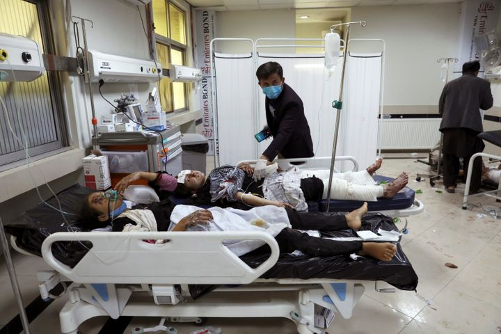 Afghan school students are treated at a hospital after a bomb explosion near a school in west of Kabul, Afghanistan, Saturday