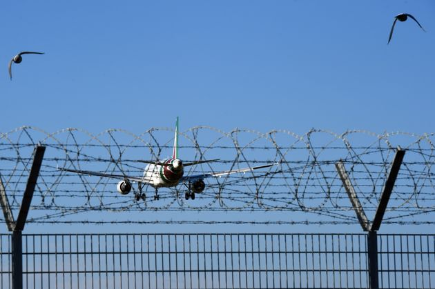 Airbus A319 Alitalia. Aircraft landing at Leonardo da Vinci International Airport in Fiumicino. Fiumicino...