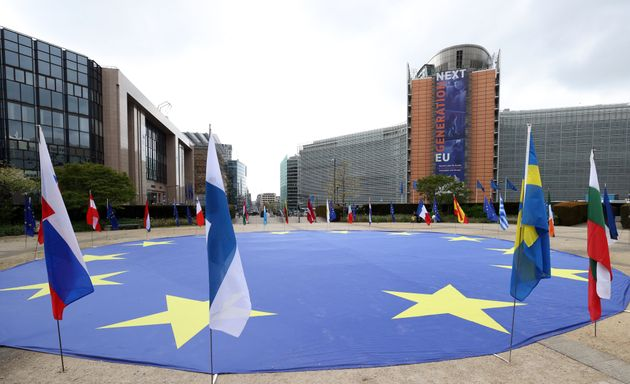 BRUSSELS, BELGIUM - MAY 8: Flags of 27 member states and a giant European Union (EU) flag are seen at...