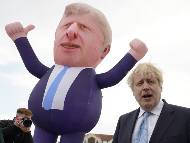 Boris Johnson in front of a giant inflatable of himself as he meets and newly elected Tory MP Jill Mortimer...