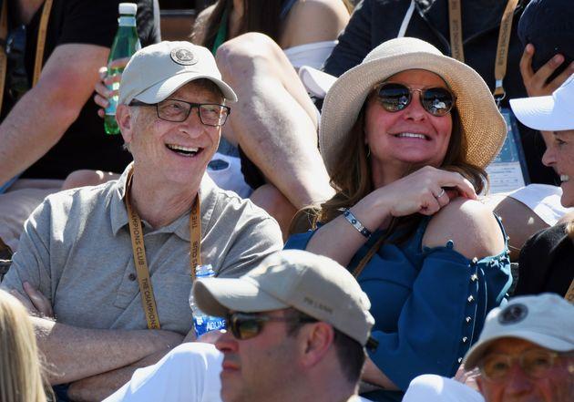 Bill Gates & Melinda Gates having fun in the stands during a tennis match between Hubert Hurkacz...