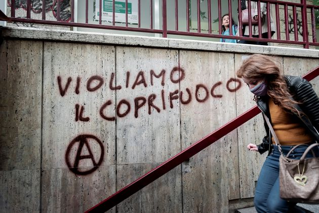 ROME, ITALY - APRIL 26: Graffiti against the 10 p.m. curfew imposed by the government of Prime Minister...