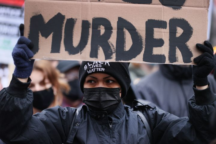 Demonstrators protest near the Hennepin County Courthouse in Minneapolis on April 19, 2021, as the jury deliberated in the tr