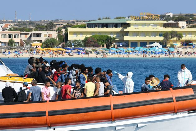 Migrants from Tunisia and Lybia are examined as they arrive onboard of an Italian Guardia Costiera (Coast...