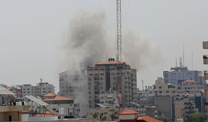 Smoke rises from an apartment in Gaza City after Israeli warplanes conducted airstrikes in various parts of Gaza Strip on May