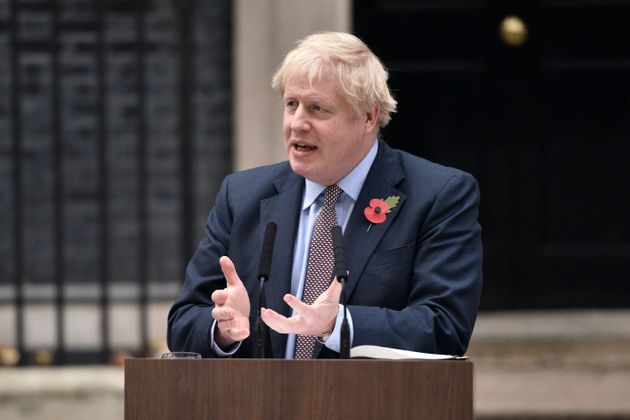 Prime Minister Boris Johnson gestures as he addresses the nation at 10 Downing