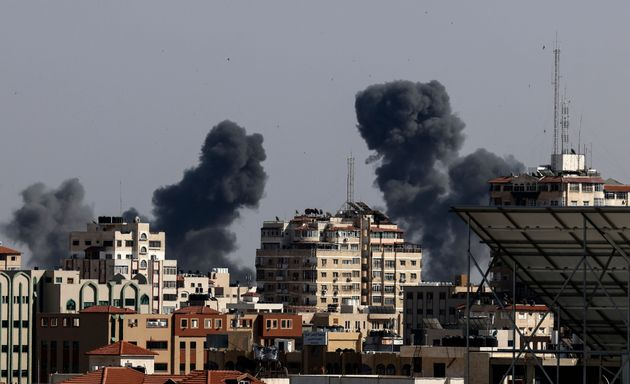 Smoke billows from Israeli air strikes in the Gaza Strip, controlled by the Palestinian Islamist movement...