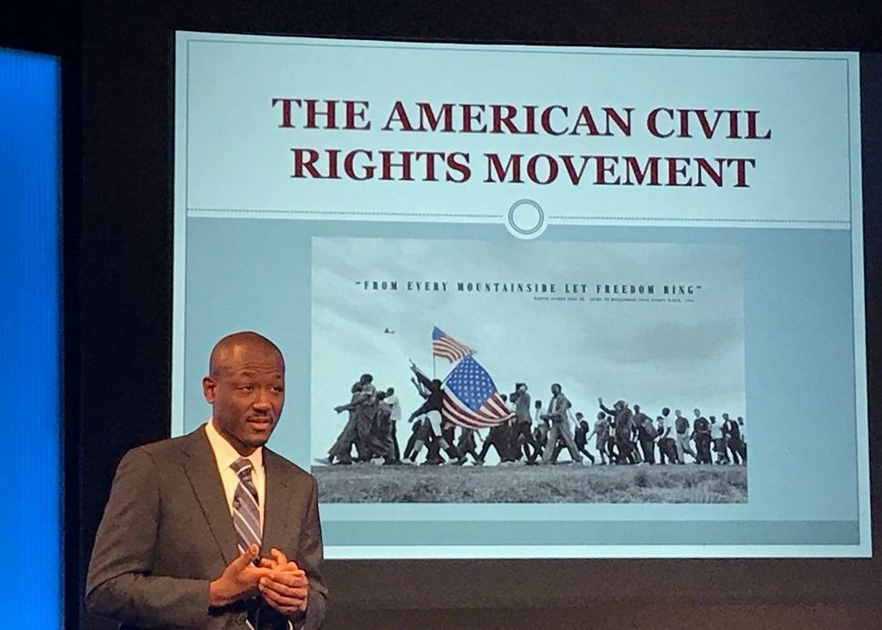Chris Richardson giving a presentation on Black History Month in Madrid in 2018. Like many well-regarded diplomats, he left t