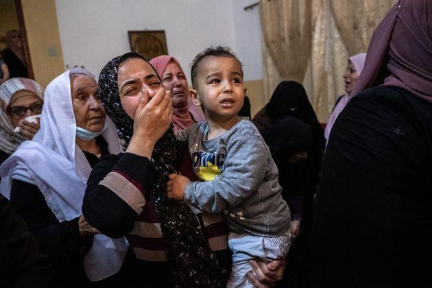 GAZA CITY, GAZA - MAY 11: Relatives of Palestinian Ahmed Al-Shenbari, who was killed during an Israeli...