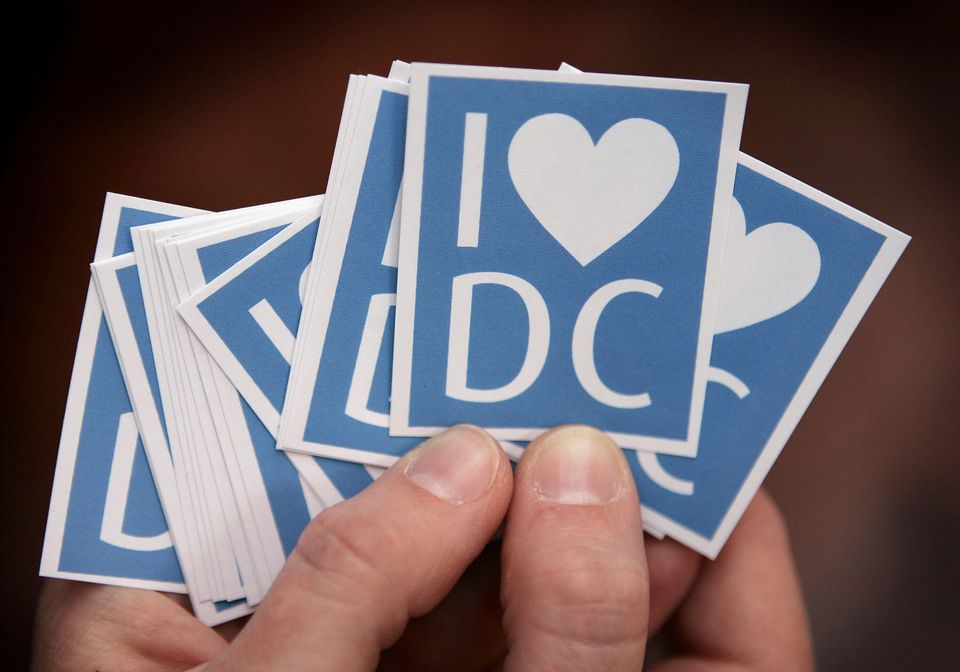 Stickers declaring their love of David Cameron are displayed at the 2005 Tory conference as he ran for...