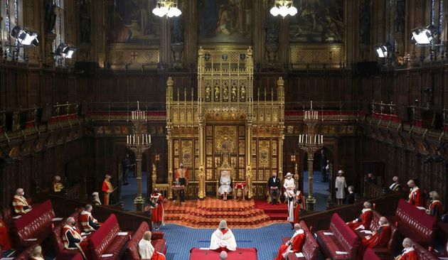 Britain's Queen Elizabeth II reads the Queen's Speech on the The Sovereign's Throne in a socially distanced...