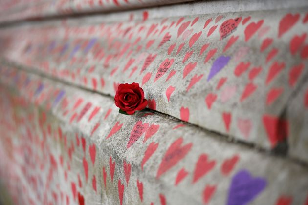 A red rose is attached to the National Covid Memorial Wall on the embankment on the south side of the...