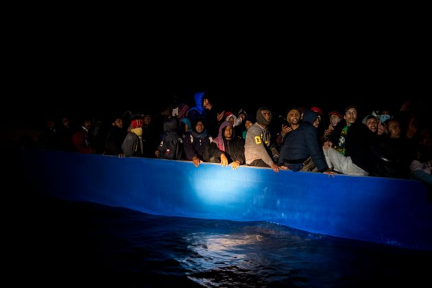 AT SEA - MARCH 29: The focus of a rescue boat from the NGO Open Arms focuses on a wooden boat with approximately...