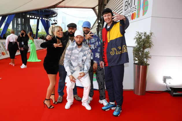 Sheridan Smith poses with the Kurupt FM team backstage at the