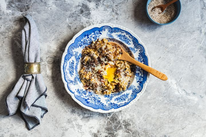 Savory oats, like the ones seen here with eggs, can help prevent sugar crashes later in the day.