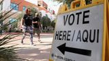 SURPRISE, ARIZONA - NOVEMBER 03: Sadiq and Dana Daniels cross the street after voting at the Surprise Court House polling location on November 03, 2020 in Surprise, Arizona.  After a record-breaking early voting turnout, Americans head to the polls on the last day to cast their vote for incumbent U.S. President Donald Trump or Democratic nominee Joe Biden in the 2020 presidential election. (Photo by Christian Petersen/Getty Images)