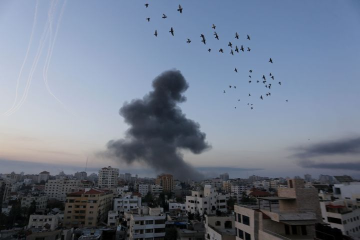 Smoke and flames rise after Israeli warplanes conducted airstrikes in Gaza City, Gaza on Wednesday.