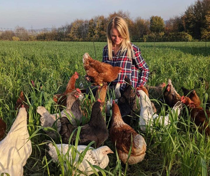 Abby Johnson surrounded by her HenPals hens.